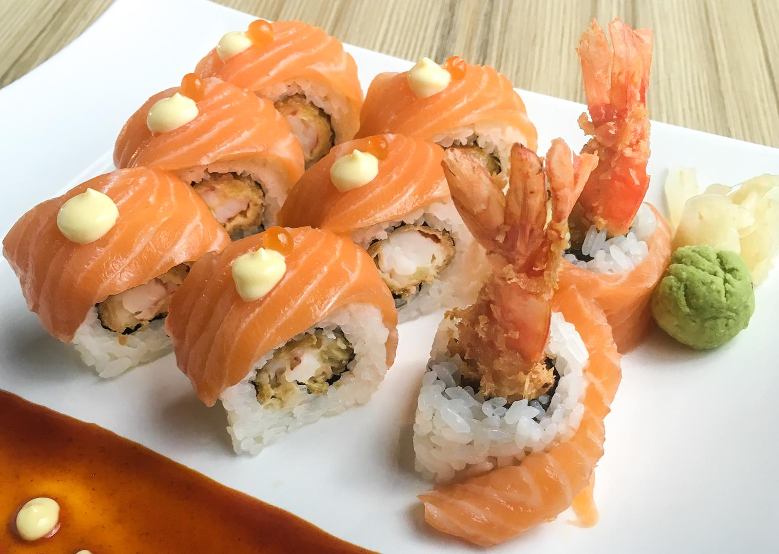 Salmon rolls are made more delectable with ebi tempura filling.