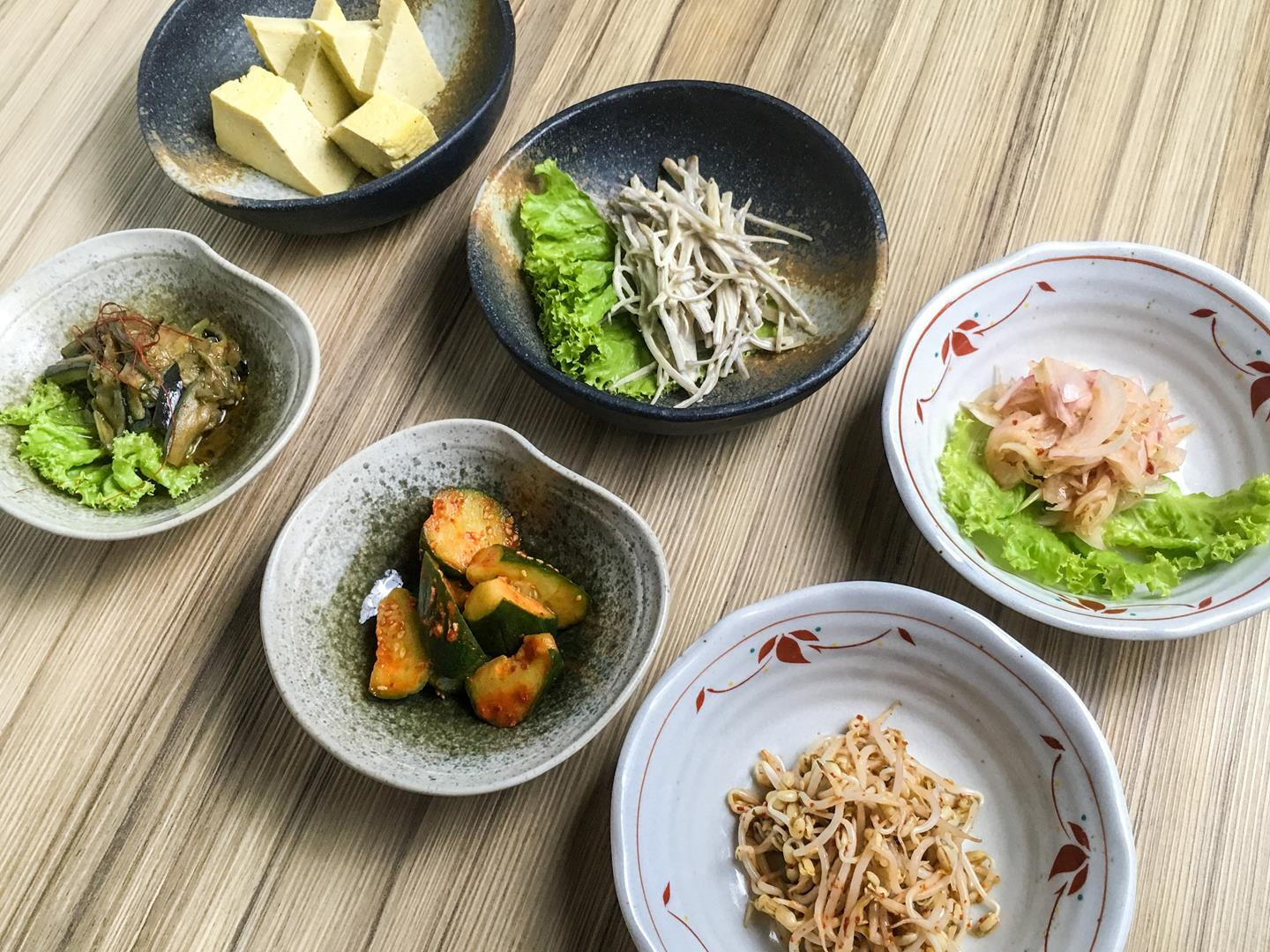 Bowls of bean sprouts, cucumber, eggplant, tofu, and shallots form part of Kitsho's Father's Day special set menu.
