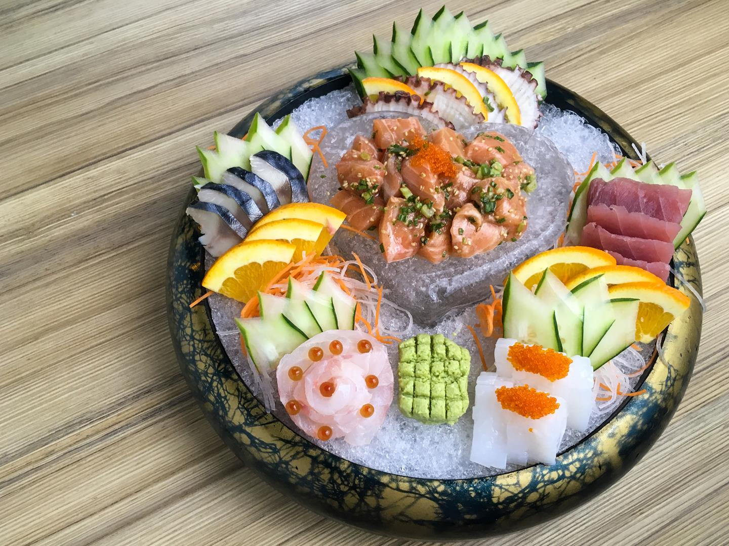 This ice-filled heart-shaped sashimi platter is filled with various morsels of succulent .seafood.