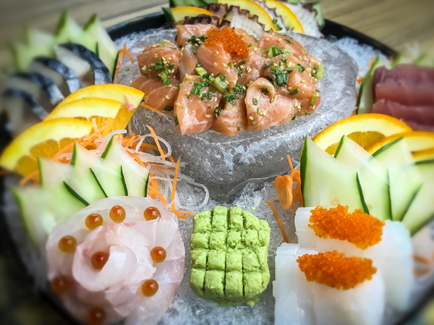 This ice-filled heart-shaped sashimi platter is filled with various morsels of succulent seafood.